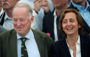 Gauland and von Storch of the anti-immigration party Alternative for Germany (AfD) smile before first exit polls during the Mecklenburg-Vorpommern state election at the party post election venue in Schwerin